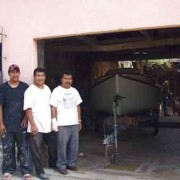"The three artisans most involved in building the boat, Alejandro Morales, Francisco ""Chico"" Vásquez  and David Ramírez, pose just before the boat leaves the shop"