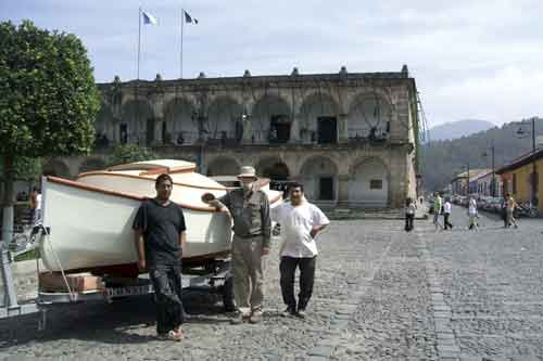 The author and two La Antigua cabinet makers turned boat builders next to the catboat at central park, La Antigua