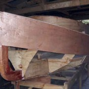 The first topsides plank, the cabin sides and part of the first bilge planks are fastened
