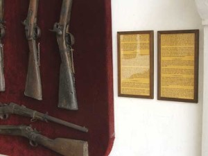 Descriptive labels identifying antique muskets, prepared and donated to the museum by a new resident to La Antigua.