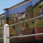 Murals cover the walls on the way in to Comalapa