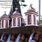 Young women of San Pedro carry the statue of the Virgin Mary. (photo: Victoria Stone)