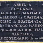 Plaque on outside wall of restaurant on 4a calle identifies site of Hospital Real de Santiago.