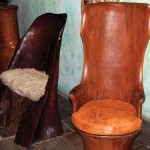 Chairs urged from the natural shape of logs with minimal carving and finishing