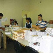Colegio Hebrón staff preparing textbooks