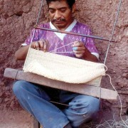 Man making a morral, note linking technique (San Andrés Huista)
