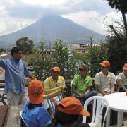 A guided tour group prepares to journey to the celebrations at Santiago Sacatepéquez