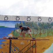 Putting the finishing touches on the mural at Escuela Mariano Navarrete