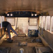 The bus interior is completely gutted, windows and seats are removed and bad parts are replaced.
