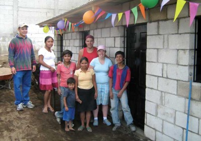 A family from San Miguel Dueñas celebrating their new home