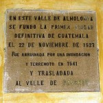 Plaque on wall of Ciudad Vieja municipal building claims founding of the first city of Guatemala in 1527 and its ruin by flood and earthquake in 1541.
