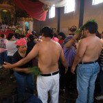 Two worshipers in San Andrés Itzapa receive a ritualistic cleansing by Thor Janson