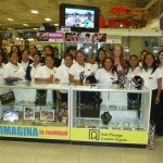 Members of Creamos behind of one of their jewelry display stands