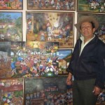 Oscar Perén with some of his paintings in his gallery