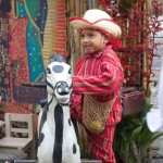 Child dressed in typical clothing for the Feast of Our Lady of Guadalupe in Antigua Guatemala (photo by Cesar Tian)