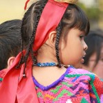 Girl dressed with typical clothing for the Feast of Our Lady of Guadalupe in Antigua Guatemala (photo by Rudy Giron)