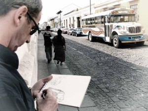 Photographer drawing a bus (image by photos.rudygiron.com)