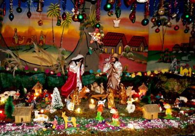 "3rd PLACE by judges vote ""El Nacimiento de La Abuelita"" by Leslie Pappa. Prize: Q50"