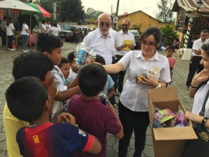 Victoria Arrivillaga is delivering gifts to children during the Christmas Celebration. Photo by Hada Cruz
